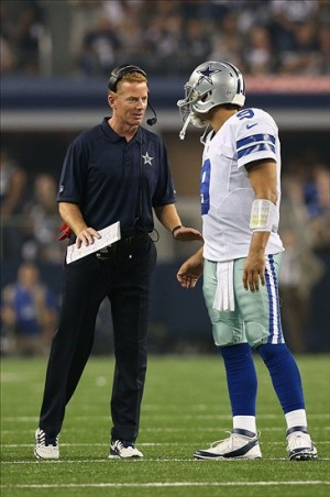 Sep 8, 2013; Arlington, TX, USA; Dallas Cowboys quarterback Tony Romo (9) talks with head coach Jason Garrett in the third quarter against the New York Giants at AT