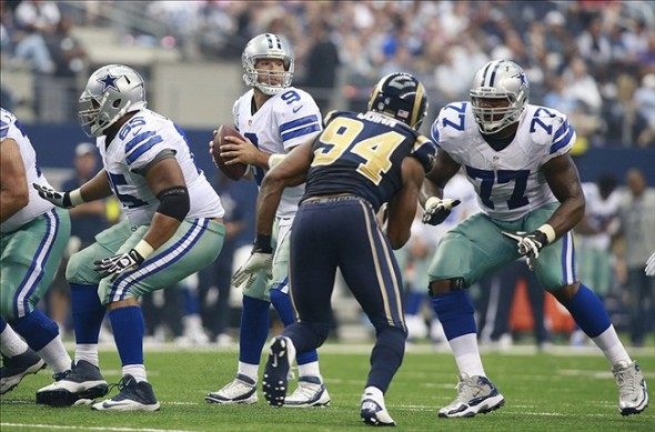Sep 22, 2013; Arlington, TX, USA; Dallas Cowboys quarterback Tony Romo (9) throws a pass against the St. Louis Rams in the fourth quarter of the game at AT