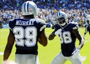 Sep 29, 2013; San Diego, CA, USA; Dallas Cowboys receiver Dez Bryant (88) celebrates with running back DeMarco Murray (29) after a touchdown during the second quarter against the San Diego Chargers at Qualcomm Stadium. Mandatory Credit: Christopher Hanewinckel-USA TODAY Sports