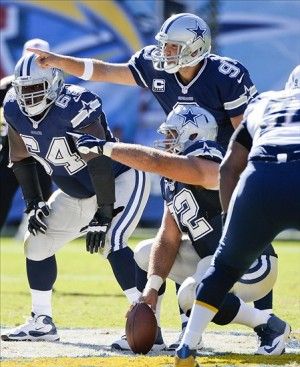Sep 29, 2013; San Diego, CA, USA; Dallas Cowboys quarterback Tony Romo (9) calls a play as center Travis Frederick (72) points at the San Diego Charger defense during third quarter action at Qualcomm Stadium. Mandatory Credit: Robert Hanashiro-USA TODAY Sports