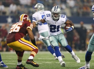 Oct 13, 2013; Arlington, TX, USA; Dallas Cowboys running back Joseph Randle (21) runs with the ball against Washington Redskins cornerback Josh Wilson (26) in the third quarter at AT