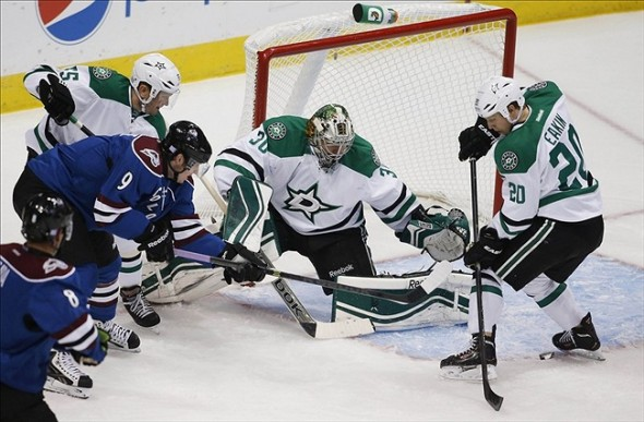 Oct 15, 2013; Denver, CO, USA; Dallas Stars goalie Dan Ellis (30) and center Cody Eakin (20) defend a shot from Colorado Avalanche center Matt Duchene (9) during the first period at Pepsi Center. Mandatory Credit: Chris Humphreys-USA TODAY Sports