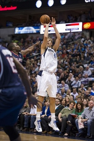 Oct 30, 2013; Dallas, TX, USA; Dallas Mavericks power forward Dirk Nowitzki (41) makes a jump shot against the Atlanta Hawks during the first quarter at American Airlines Center. Mandatory Credit: Jerome Miron-USA TODAY Sports