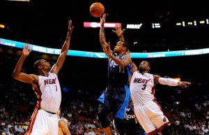 Nov 15, 2013; Miami, FL, USA; Dallas Mavericks shooting guard Monta Ellis (11) is pressured by Miami Heat center Chris Bosh (1) and Miami Heat shooting guard Dwyane Wade (3) during the first half at American Airlines Arena. Mandatory Credit: Steve Mitchell-USA TODAY Sports