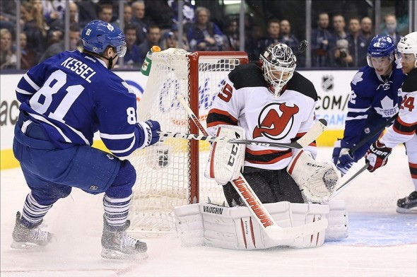 Jan 12, 2014; Toronto, Ontario, CAN; New Jersey Devils goalie Cory Schneider (35) stops Toronto Maple Leafs right wing Phil Kessel (81) in close at Air Canada Centre. The Maple Leafs beat the Devils 3-2. Mandatory Credit: Tom Szczerbowski-USA TODAY Sports