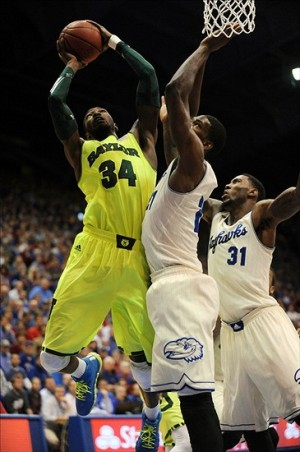 Jan 20, 2014; Lawrence, KS, USA; Baylor Bears forward Cory Jefferson (34) shoots a layup as Kansas Jayhawks center Joel Embiid (21) defends during the first half at Allen Fieldhouse. Mandatory Credit: Denny Medley-USA TODAY Sports