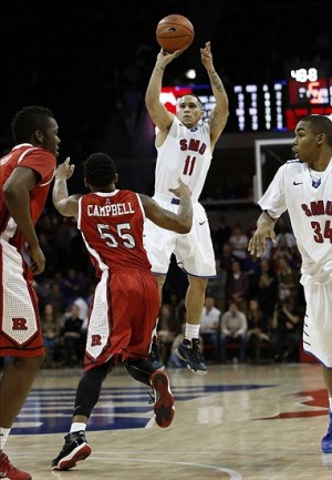 Jan 21, 2014; Dallas, TX, USA; Southern Methodist Mustangs guard Nic Moore (11) shoots the ball over Rutgers Scarlet Knights guard D