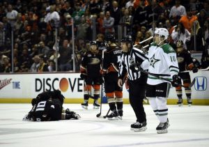 Apr 25, 2014; Anaheim, CA, USA; Anaheim Ducks right wing Corey Perry (10) lays on the ground after Dallas Stars left wing Ryan Garbutt (16) commits a foul for spearing during the first period in game five of the first round of the 2014 Stanley Cup Playoffs at Honda Center. Mandatory Credit: Kelvin Kuo-USA TODAY Sports