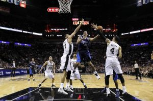 Apr 30, 2014; San Antonio, TX, USA; Dallas Mavericks guard Devin Harris (20) shoots the ball as San Antonio Spurs forward Tim Duncan (21) and guard Danny Green (4) defend in game five of the first round of the 2014 NBA Playoffs at AT&T Center. The Spurs won 109-103. Mandatory Credit: Soobum Im-USA TODAY Sports