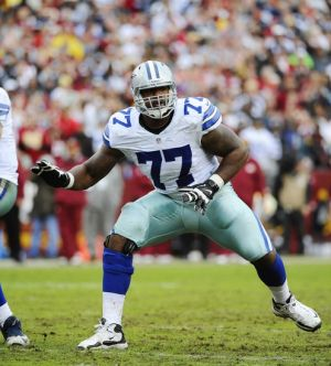 Dec 22, 2013; Landover, MD, USA; Dallas Cowboys offensive tackle Tyron Smith (77) prepares to block against the Washington Redskins during the first half at FedEx Field. Mandatory Credit: Brad Mills-USA TODAY Sports