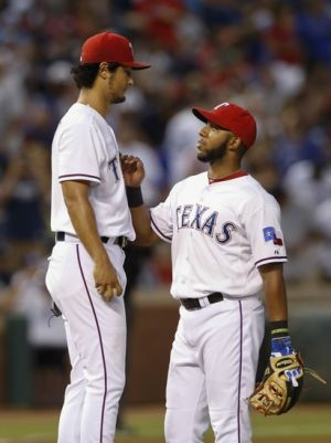 Jul 28, 2014; Arlington, TX, USA; Texas Rangers starting pitcher Yu Darvish (11) speaks with shortstop Elvis Andrus (1) during the game against the New York Yankees at Globe Life Park in Arlington. Mandatory Credit: Kevin Jairaj-USA TODAY Sports