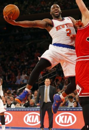 Apr 13, 2014; New York, NY, USA; New York Knicks guard Raymond Felton (2) drives to the basket during the second half against the Chicago Bulls at Madison Square Garden. New York Knicks defeat the Chicago Bulls 100-89. Mandatory Credit: Jim O