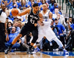 Apr 26, 2014; Dallas, TX, USA; San Antonio Spurs forward Tim Duncan (21) drives on Dallas Mavericks forward Shawn Marion (0) during the game in game three of the first round of the 2014 NBA Playoffs at American Airlines Center. Dallas won 109-108. Mandatory Credit: Kevin Jairaj-USA TODAY Sports