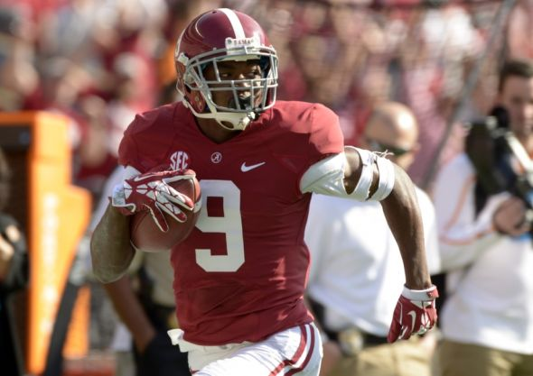 Oct 26, 2013; Tuscaloosa, AL, USA; Alabama Crimson Tide wide receiver Amari Cooper (9) carries 54-yards for a touchdown against the Tennessee Volunteers during the first quarter at Bryant-Denny Stadium. Mandatory Credit: John David Mercer-USA TODAY Sports