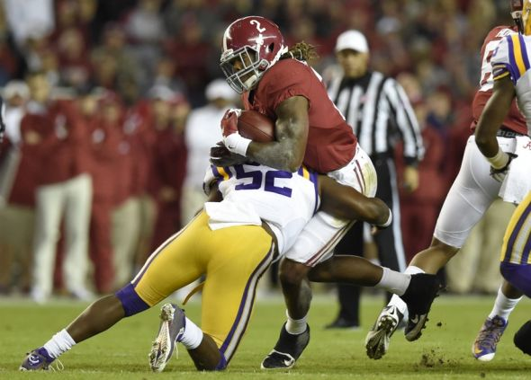 Nov 7, 2015; Tuscaloosa, AL, USA; Alabama Crimson Tide running back Derrick Henry (2) is tackled by LSU Tigers linebacker Kendell Beckwith (52) during the first quarter at Bryant-Denny Stadium. Mandatory Credit: John David Mercer-USA TODAY Sports