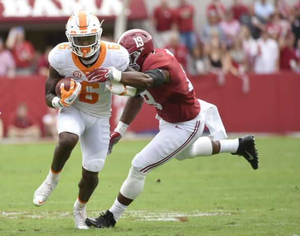 Oct 24, 2015; Tuscaloosa, AL, USA; Tennessee Volunteers running back Alvin Kamara (6) carries the ball against Alabama Crimson Tide linebacker Reggie Ragland (19) during the first quarter at Bryant-Denny Stadium. Mandatory Credit: John David Mercer-USA TODAY Sports