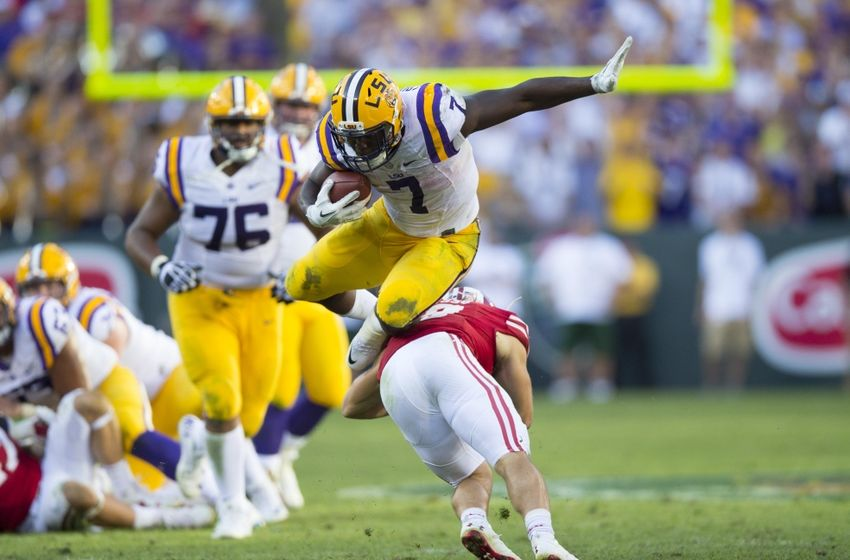 Sep 3, 2016; Green Bay, WI, USA;   LSU Tigers running back Leonard Fournette (7) leaps over Wisconsin Badgers safety Leo Musso (19) during the fourth quarter at Lambeau Field. Mandatory Credit: Jeff Hanisch-USA TODAY Sports
