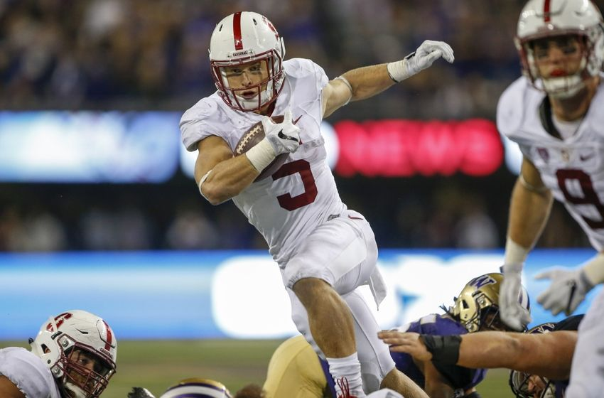 Sep 30, 2016; Seattle, WA, USA; Stanford Cardinal running back Christian McCaffrey (5) rushes the ball against the Washington Huskies during the second half at Husky Stadium. Washington won 44-6. Mandatory Credit: Jennifer Buchanan-USA TODAY Sports