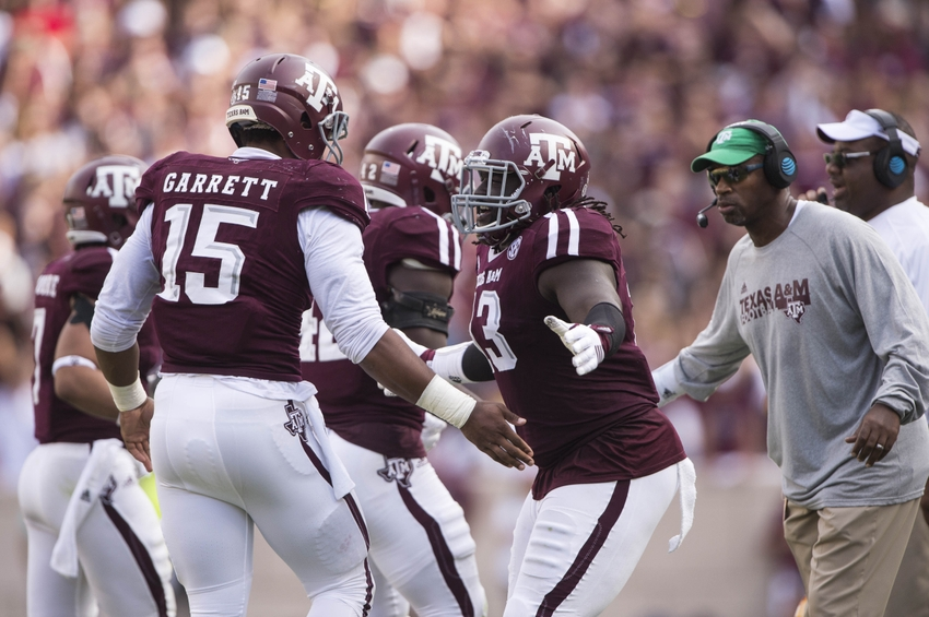 Oct 8, 2016; College Station, TX, USA; Texas A&M Aggies defensive lineman Myles Garrett (15) and defensive lineman Reggie Chevis (13) celebrate a defensive stop against the Tennessee Volunteers during the second quarter at Kyle Field. Mandatory Credit: Jerome Miron-USA TODAY Sports