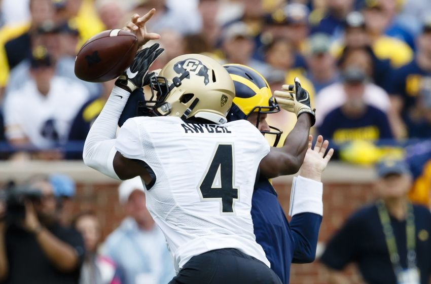 Sep 17, 2016; Ann Arbor, MI, USA; Colorado Buffaloes defensive back Chidobe Awuzie (4) rushes on Michigan Wolverines quarterback Wilton Speight (3) and causes a fumble in the first quarter at Michigan Stadium. Mandatory Credit: Rick Osentoski-USA TODAY Sports