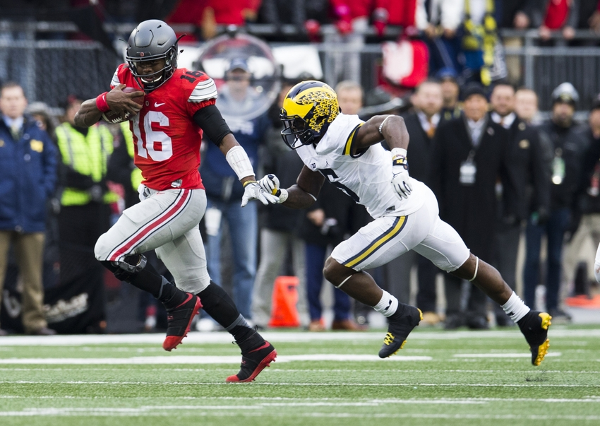 Nov 26, 2016; Columbus, OH, USA; Ohio State Buckeyes quarterback J.T. Barrett (16) sprints upfield as Michigan Wolverines linebacker Jabrill Peppers (5) pursues during the third quarter at Ohio Stadium. Ohio State won the game 30-27 in double overtime. Mandatory Credit: Greg Bartram-USA TODAY Sports