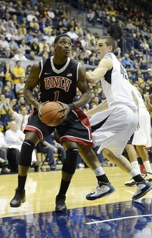 December 6, 2012; Berkeley, CA, USA; UNLV Runnin Rebels guard Justin Cobbs (01) defended under the basket by California Golden Bears forward Mike Moser (43) during the second half at Haas Pavilion.  UNLV won 76-75. Mandatory Credit: Bob Stanton-USA TODAY Sports
