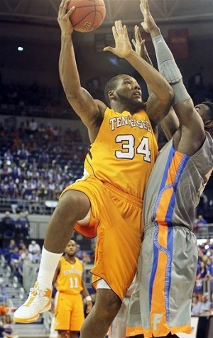 February 11, 2012; Gainesville, FL, USA; Tennessee Volunteers forward Jeronne Maymon (34) shoots as Florida Gators forward/center Patric Young (4) defends during the first half at the Stephen C. O