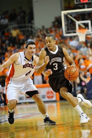 Mar 7, 2012; Lewisburg, PA, USA; Lehigh Mountain Hawks guard C.J. McCollum (3) drives to the basket as Bucknell Bison guard Bryan Cohen (4) defends in the second half during the finals of the 2012 Patriot League Conference Tournament at Sojka Pavilion. Lehigh won 82-77. Mandatory Credit: James Lang-USA TODAY Sports