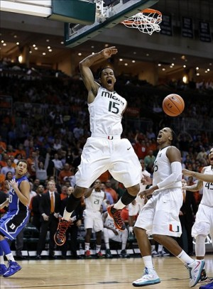 Jan 23, 2013; Coral Gables, FL, USA; Miami Hurricanes guard Rion Brown (15) and forward/center Kenny Kadji (35) react after a basket against the Duke Blue Devils in the second half at the BankUnited Center. Miami won 90-63. Mandatory Credit: Robert Mayer-USA TODAY Sports