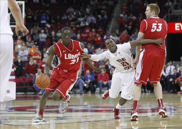 February 13, 2013; Fresno, CA, USA; New Mexico Lobos guard Kendall Williams (10) catches a pass ahead of Fresno State Bulldogs guard Tyler Johnson (1) in the second half at the Save Mart Center. The Lobos defeated the Bulldogs 54-48. Mandatory Credit: Cary Edmondson-USA TODAY Sports