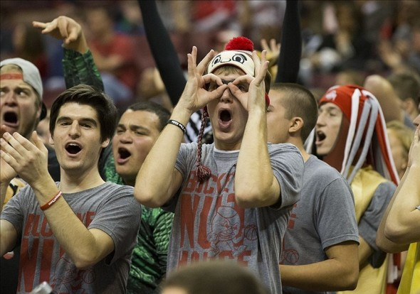 Dec 4, 2013; Columbus, OH, USA; Ohio State Buckeyes fans react to a three-point basket against the Maryland Terrapins at the Schottenstein Center. Mandatory Credit: Greg Bartram-USA TODAY Sports