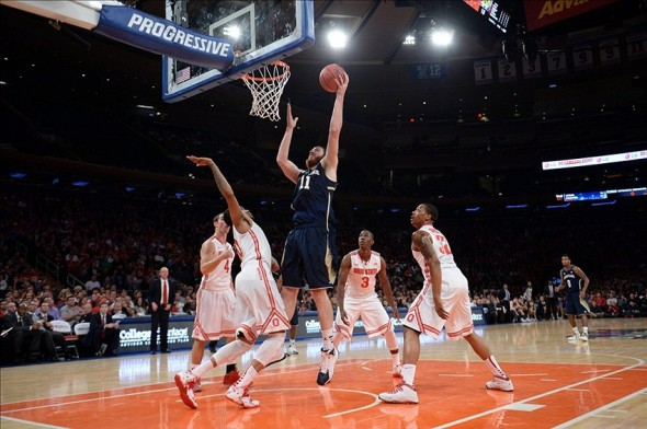 Dec 21, 2013; New York, NY, USA; Notre Dame Fighting Irish center Garrick Sherman (11) puts up a shot amidst Ohio State Buckeyes defenders during the first half of the Gotham Classic at Madison Square Garden. Mandatory Credit: Joe Camporeale-USA TODAY Sports