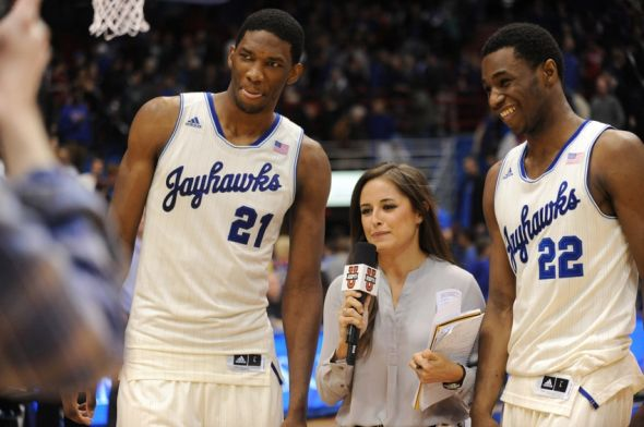 Feb 22, 2014; Lawrence, KS, USA; Kansas Jayhawks center Joel Embiid (21) and guard Andrew Wiggins (22) speak with media after the game against the Texas Longhorns at Allen Fieldhouse. Kansas won 85-54. Mandatory Credit: Denny Medley-USA TODAY Sports