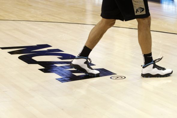Mar 19, 2014; Orlando, FL, USA; General view of the NCAA logo during the Colorado Buffaloes practice before the second round of the 2014 NCAA Tournament at Amway Center. Mandatory Credit: Kim Klement-USA TODAY Sports