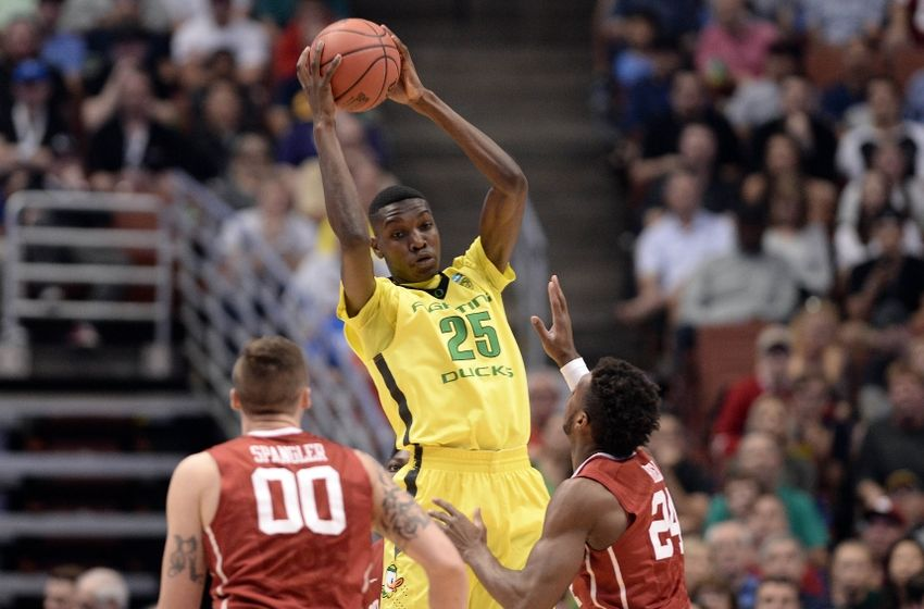 March 26, 2016; Anaheim, CA, USA; Oregon Ducks forward Chris Boucher (25) controls the ball against Oklahoma Sooners guard Buddy Hield (24) and forward Ryan Spangler (00) during the first half of the West regional final of the NCAA Tournament at Honda Center. Mandatory Credit: Robert Hanashiro-USA TODAY Sports