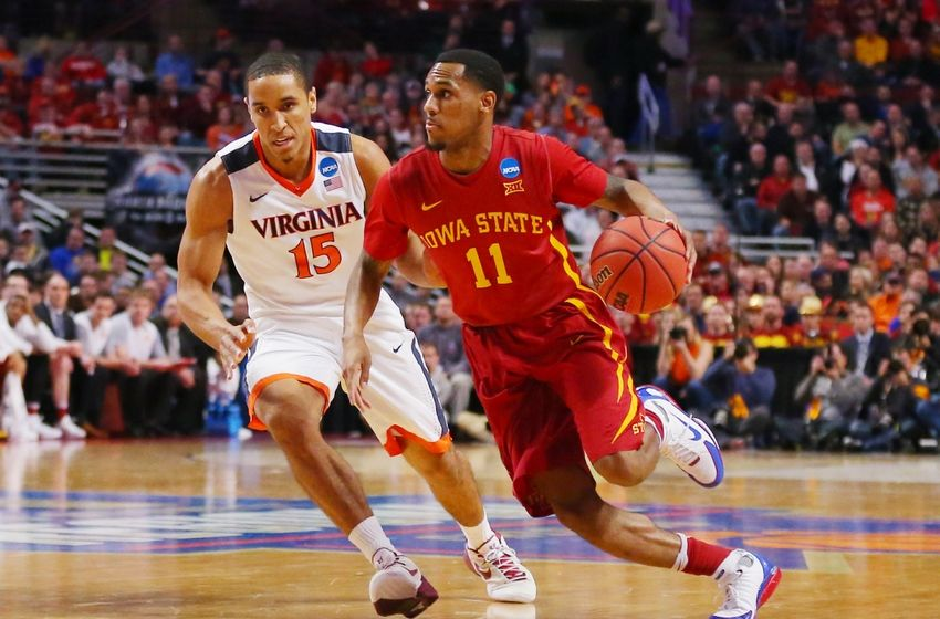 Mar 25, 2016; Chicago, IL, USA; Iowa State Cyclones guard Monte Morris (11) is defended by Virginia Cavaliers guard Malcolm Brogdonn during the first half in a semifinal game in the Midwest regional of the NCAA Tournament at United Center. Mandatory Credit: Dennis Wierzbicki-USA TODAY Sports