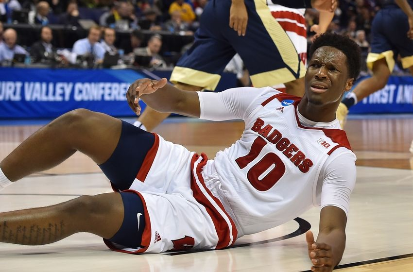 Mar 18, 2016; St. Louis, MO, USA; Wisconsin Badgers forward Nigel Hayes (10) reacts on the floor during the first half of the game in the first round against the Pittsburgh Panthers in the 2016 NCAA Tournament at Scottrade Center. Mandatory Credit: Jasen Vinlove-USA TODAY Sports