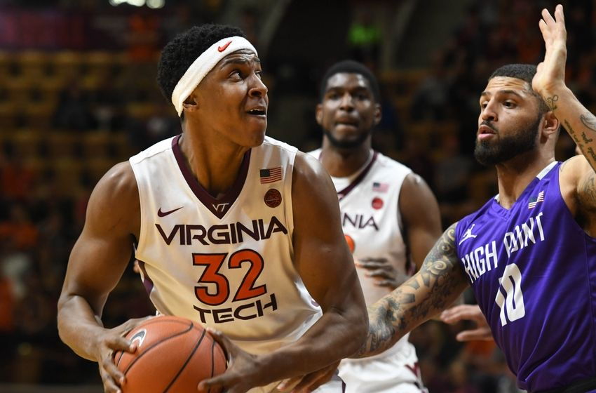 Nov 15, 2016; Blacksburg, VA, USA; Virginia Tech forward Zach LeDay (32) looks to shoot while being defended by High Point Panthers forward Tarique Thompson (10) in the second half at Cassell Coliseum. Virginia Tech defeated High Point 99-73. Mandatory Credit: Michael Shroyer-USA TODAY Sports