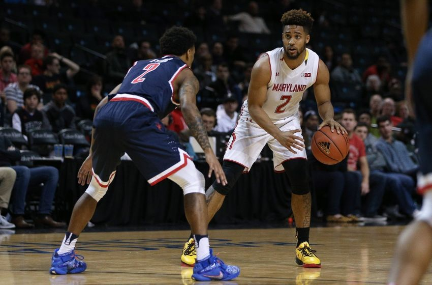 Nov 25, 2016; Brooklyn, NY, USA; Maryland Terrapins guard Melo Trimble (2) looks to pass while defended by Richmond Spiders guard Khwan Fore (2) during the first half of the second game of the Barclays Center Classic at Barclays Center. Mandatory Credit: Vincent Carchietta-USA TODAY Sports