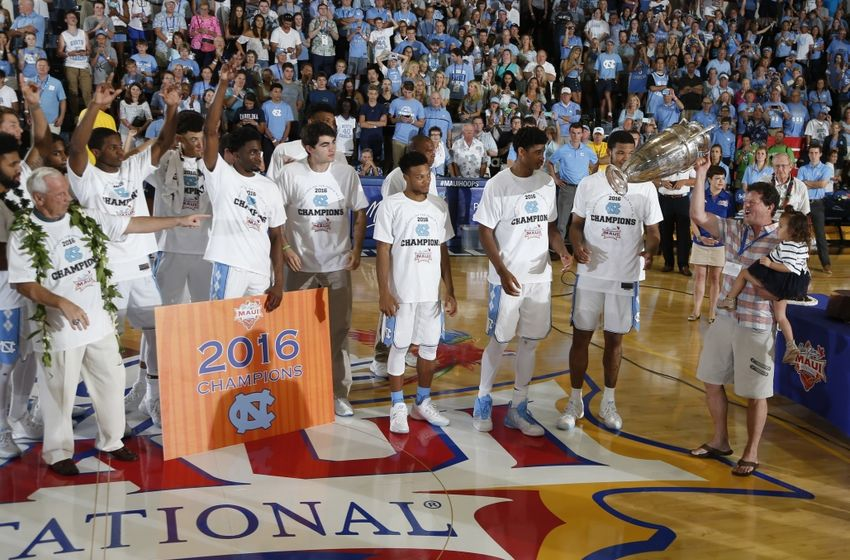 Nov 23, 2016; Lahaina, Maui, HI, USA; Walter Hester the CEO of Maui Jim presents the Wayne Duke Championship Trophy to North Carolina Tar Heels forwards Isaiah Hicks and Kennedy Meeks after defeating the Wisconsin Badgers in the Championship Game of the Maui Jim Maui Invitational at the Lahaina Civic Center. Mandatory Credit: Brian Spurlock-USA TODAY Sports