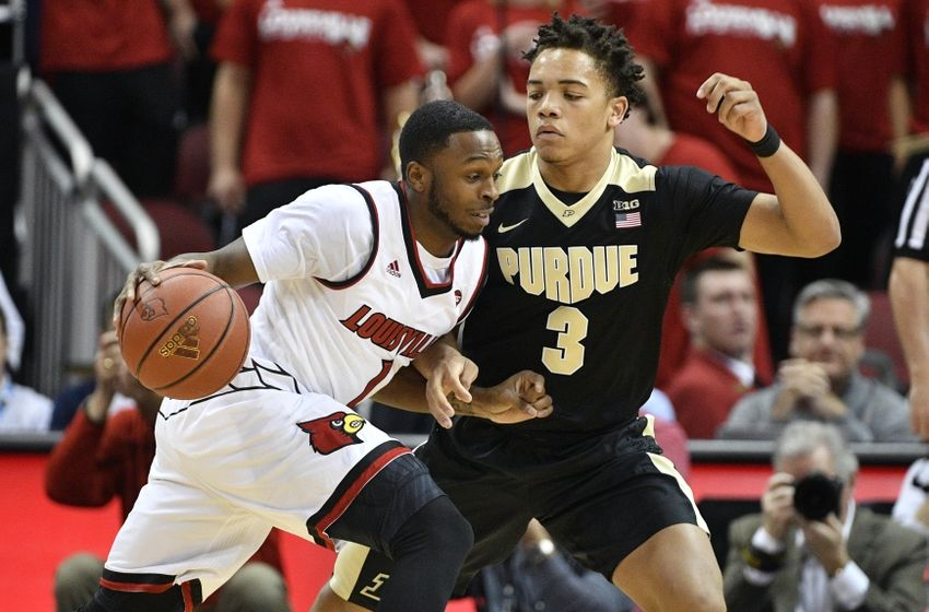 Nov 30, 2016; Louisville, KY, USA; Louisville Cardinals guard Tony Hicks (1) dribbles against Purdue Boilermakers guard Carsen Edwards (3) during the first half at KFC Yum! Center. Mandatory Credit: Jamie Rhodes-USA TODAY Sports