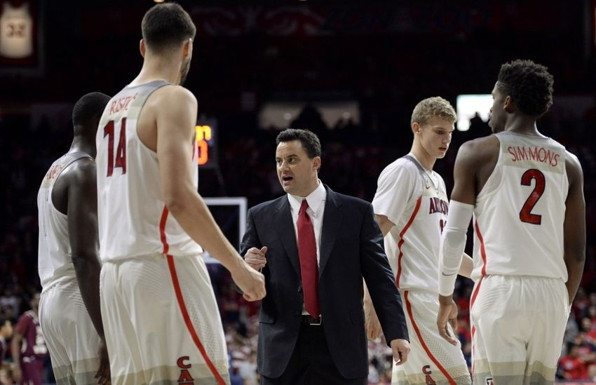 Nov 30, 2016; Tucson, AZ, USA; Arizona Wildcats head coach Sean Miller (C) talks to center Dusan Ristic (14) forward Lauri Markkanen (10) and guard Kobi Simmons (2) during the first half against the Texas Southern Tigers at McKale Center. Arizona won 85-63. Mandatory Credit: Casey Sapio-USA TODAY Sports