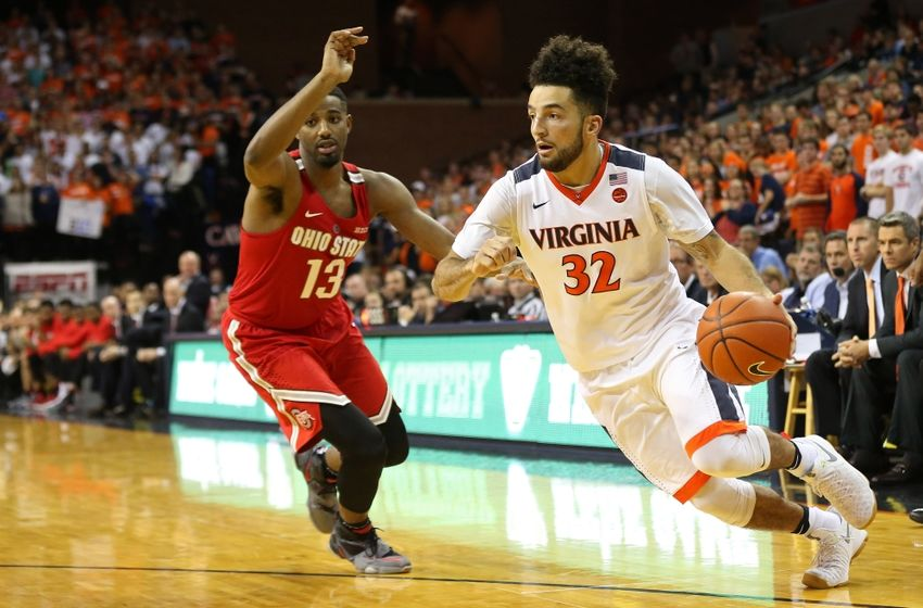 Nov 30, 2016; Charlottesville, VA, USA; Virginia Cavaliers guard London Perrantes (32) dribbles the ball past Ohio State Buckeyes guard JaQuan Lyle (13) in the second half at John Paul Jones Arena. The Cavaliers won 63-61. Mandatory Credit: Geoff Burke-USA TODAY Sports