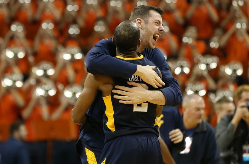Dec 3, 2016; Charlottesville, VA, USA; West Virginia Mountaineers guard Jevon Carter (2) and Mountaineers forward Maciej Bender (R) celebrate after their game against the Virginia Cavaliers at John Paul Jones Arena. The Mountaineers won 66-57. Mandatory Credit: Geoff Burke-USA TODAY Sports