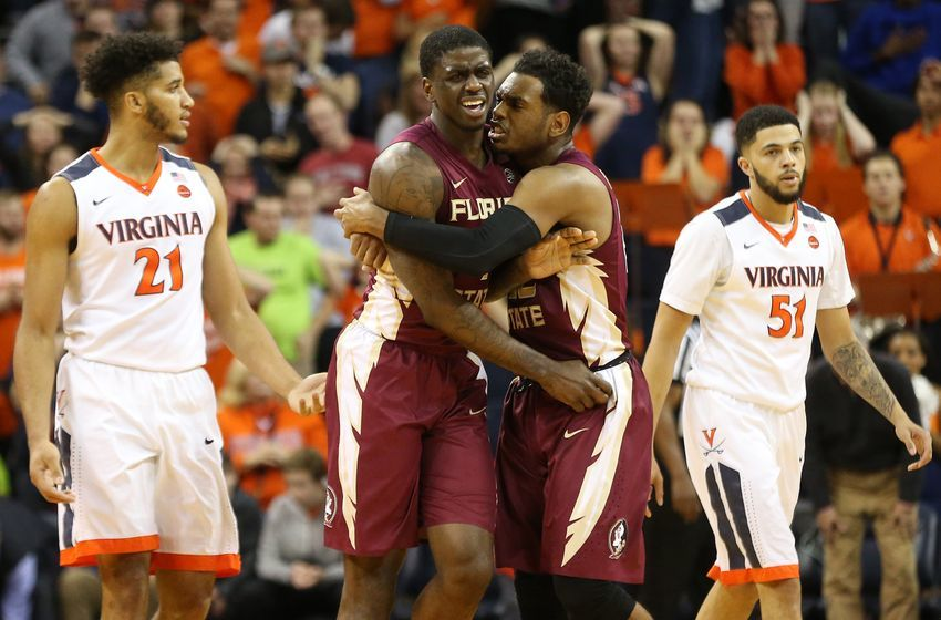 Dec 31, 2016; Charlottesville, VA, USA; Florida State Seminoles guard Dwayne Bacon (4) celebrates with Seminoles guard Xavier Rathan-Mayes (22) after making the game winning three point field goal as Virginia Cavaliers forward Isaiah Wilkins (21) and Cavaliers guard Darius Thompson (51) look on with two seconds left in the second half at John Paul Jones Arena. The Seminoles won 60-58. Mandatory Credit: Geoff Burke-USA TODAY Sports