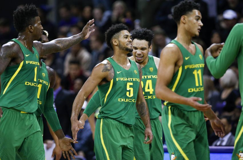 Jan 4, 2017; Seattle, WA, USA; Oregon Ducks guard Tyler Dorsey (5) is greeted by forward Dillon Brooks (24) and forward Jordan Bell (1) during a second half timeout at Alaska Airlines Arena at Hec Edmundson Pavilion. Oregon defeated Washington, 83-61. Mandatory Credit: Joe Nicholson-USA TODAY Sports