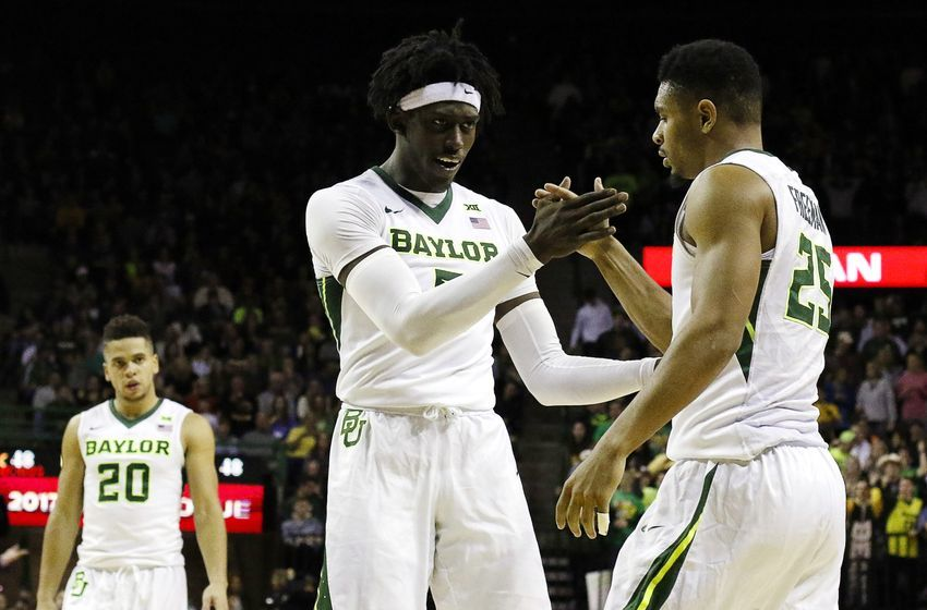 Jan 7, 2017; Waco, TX, USA; Baylor Bears forward Johnathan Motley (5) shakes the hand of guard Al Freeman (25) after picking up a foul against the Oklahoma State Cowboys during the second half at Ferrell Center. Baylor won 61-57. Mandatory Credit: Ray Carlin-USA TODAY Sports