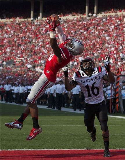 Sep 7, 2013; Columbus, OH, USA; Ohio State Buckeyes wide receiver Philly Brown (10) makes a leaping touchdown catch under pressure from San Diego State Aztecs defensive back David Lamar (16) at Ohio Stadium. Ohio State won the game 42-7. Mandatory Credit: Greg Bartram-USA TODAY Sports