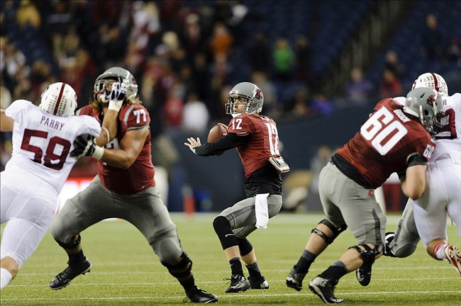 Sep 28, 2013; Seattle, WA, USA; Washington State Cougars quarterback Connor Halliday (12) passes the ball during the 1st half against the Stanford Cardinal at CenturyLink Field. Mandatory Credit: Steven Bisig-USA TODAY Sports
