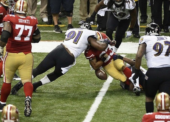 Feb 3, 2013; New Orleans, LA, USA; San Francisco 49ers running back LaMichael James (23) fumbles as he is hit by Baltimore Ravens outside linebacker Courtney Upshaw (91) during the second quarter in Super Bowl XLVII at the Mercedes-Benz Superdome. Mandatory Credit: Richard Mackson-USA TODAY Sports